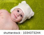 joyfol baby boy on green... | Shutterstock . vector #1034373244