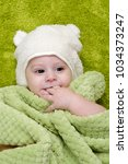 baby boy under the green towel | Shutterstock . vector #1034373247