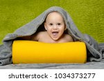 cute baby with green background | Shutterstock . vector #1034373277