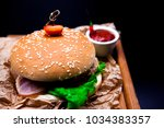 a juicy burger with marble beef ... | Shutterstock . vector #1034383357