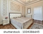 bedroom with a beautiful...   Shutterstock . vector #1034386645