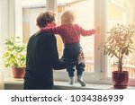 grandmother playing and taking... | Shutterstock . vector #1034386939