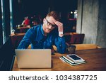 tired red haired skilled... | Shutterstock . vector #1034387725