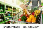 woman buying food products | Shutterstock . vector #1034389324
