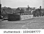 bulk carrier moored to the... | Shutterstock . vector #1034389777