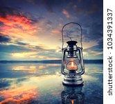 romantic evening at the beach ...   Shutterstock . vector #1034391337