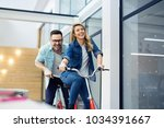 business people on twin bicycle | Shutterstock . vector #1034391667