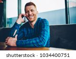 happy young man with red hair... | Shutterstock . vector #1034400751