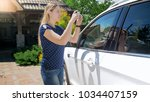 smiling woman making...   Shutterstock . vector #1034407159