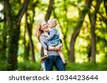 mom and little daughter  | Shutterstock . vector #1034423644