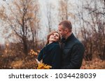 happy couple in the autumn park | Shutterstock . vector #1034428039