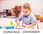 cutting kinetic sand | Shutterstock . vector #1034428069