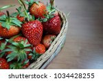 ripe strawberry in wooden... | Shutterstock . vector #1034428255