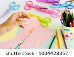 closeup on female hands cutting ... | Shutterstock . vector #1034428357