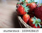 ripe strawberry in wooden... | Shutterstock . vector #1034428615