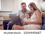 portrait of a joyful family... | Shutterstock . vector #1034440687