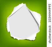 green paper with torn with... | Shutterstock .eps vector #1034444995