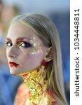 halloween makeup  visage. girl... | Shutterstock . vector #1034448811