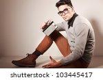 attractive man dressed casual... | Shutterstock . vector #103445417