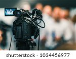 camera at media conference | Shutterstock . vector #1034456977