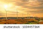 landscape wind turbine field... | Shutterstock . vector #1034457364