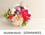 artificial flower bouquet on... | Shutterstock . vector #1034464651