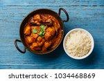 chicken tikka masala spicy... | Shutterstock . vector #1034468869