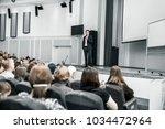 speaker speaks at a business... | Shutterstock . vector #1034472964