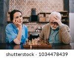 bored nurse and elder man...   Shutterstock . vector #1034478439