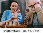 nurse and senior man passionate ...   Shutterstock . vector #1034478445