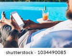 cropped image of man lying near ... | Shutterstock . vector #1034490085