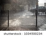 rain in the city. road ... | Shutterstock . vector #1034500234