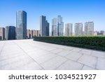 empty floor with modern building | Shutterstock . vector #1034521927