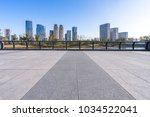 empty floor with modern building | Shutterstock . vector #1034522041