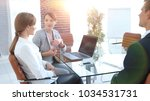 business team discussing... | Shutterstock . vector #1034531731