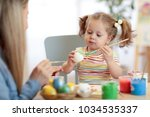 mother and child daughter are... | Shutterstock . vector #1034535337