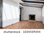 unfurnished room with large... | Shutterstock . vector #1034539354