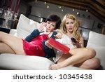 domestic life  2 girls watching ...   Shutterstock . vector #10345438