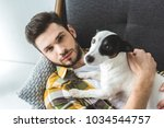 Stock photo handsome young man with dog 1034544757