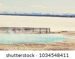 wooden boardwalk along geyser... | Shutterstock . vector #1034548411