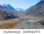 mountain lake located in the... | Shutterstock . vector #1034561971