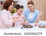 three generations of women... | Shutterstock . vector #1034563279