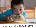 serious mongolian boy at the... | Shutterstock . vector #1034563771