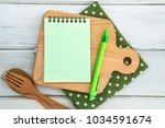 notepad on chopping board with ... | Shutterstock . vector #1034591674