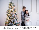 charming young couple hugs  in... | Shutterstock . vector #1034603107