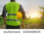 engineer or architect  wearing... | Shutterstock . vector #1034608534