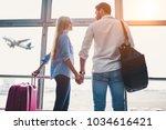 romantic couple in airport.... | Shutterstock . vector #1034616421