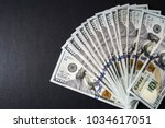 Small photo of USD 100 dollars, many standing on a black background USD dollars
