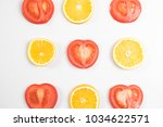 tomatoes and oranges creative | Shutterstock . vector #1034622571