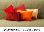 colorful warm pillows on the... | Shutterstock . vector #1034631541